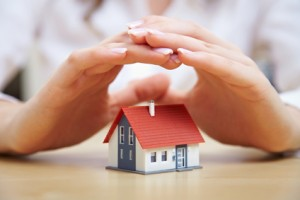 Insurance image - Hands protecting house